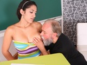 Lara begins to slide off her top and her teacher puts his mouth all over her young and busty breasts.