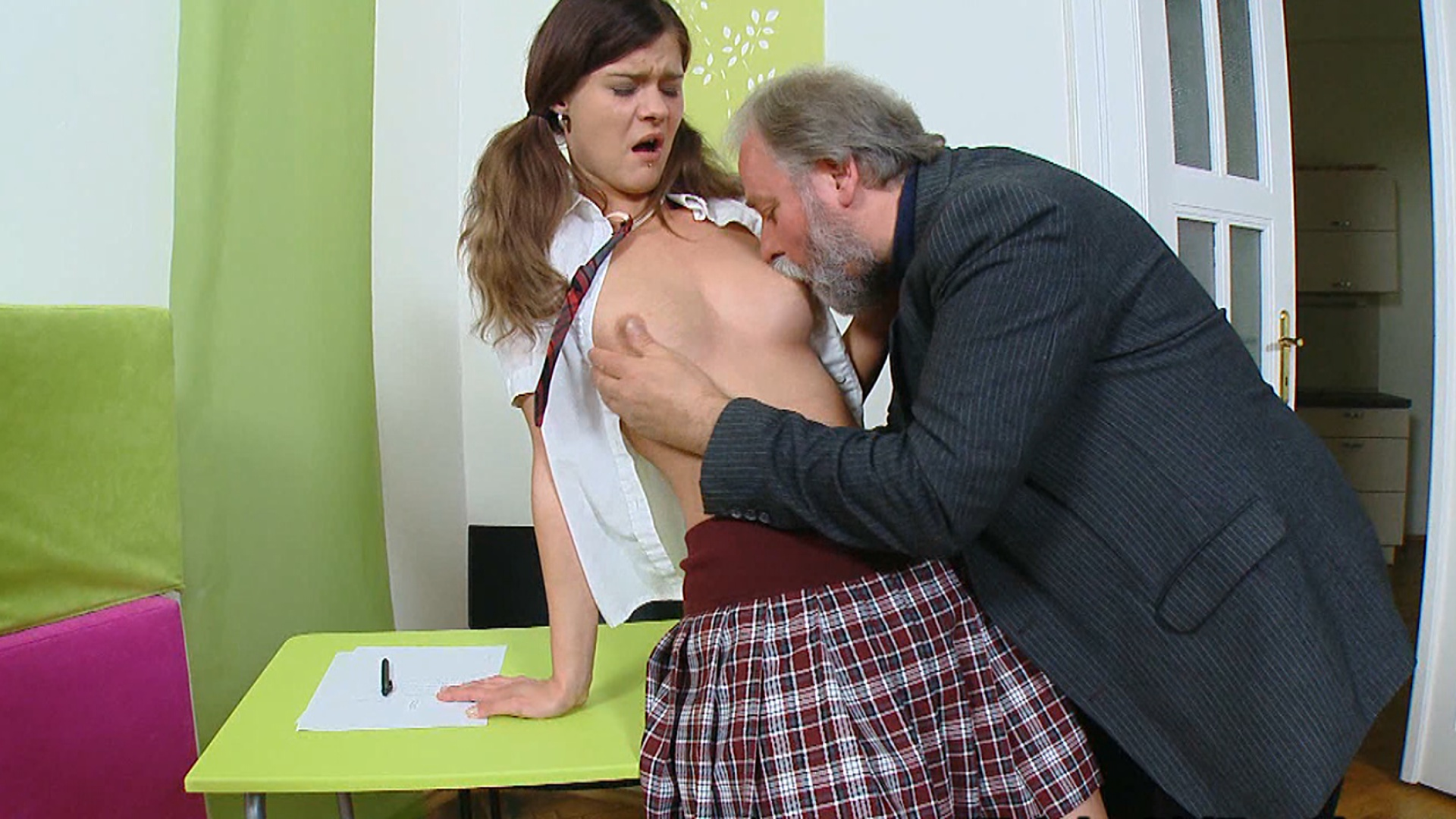 Nadya has her legs spread wide open on the desk and fucked hard by him in class.