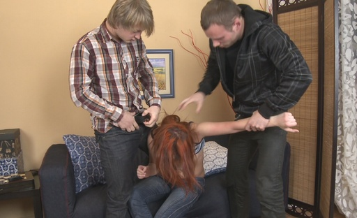 Red haired slut has her holes stuffed with erected dicks