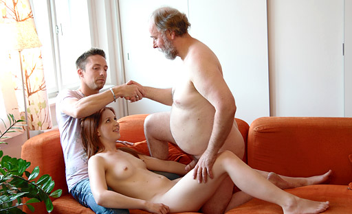 Sveta has her face held by her lover as his older friend finishes fucking her young body and cums