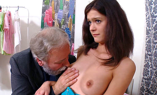 Nadya is on her back being fucked hard by her older sexier lover and screams.