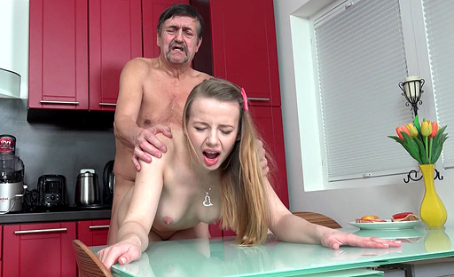 Cute young Dana gets fucked in the kitchen by daddy's friend