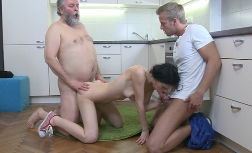 Karina is fucked doggie style by her older lover and sucks her lover's cock in a threesome.